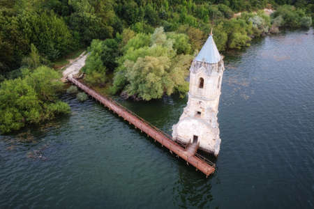 Aerial view of The fish cathedral. Sunken church ruins located in the Ebro reservoir in Cantabria, in the north of Spain. High quality photo Stock Photo - 151305016