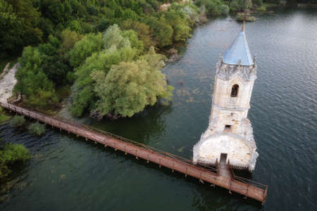 Aerial view of The fish cathedral. Sunken church ruins located in the Ebro reservoir in Cantabria, in the north of Spain. High quality photo Stock Photo