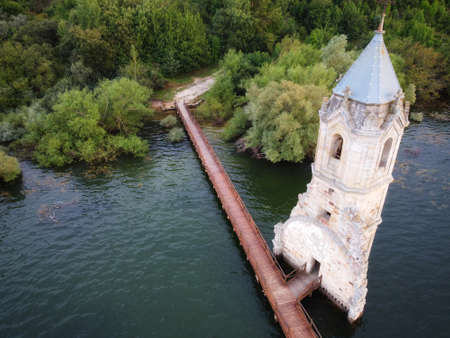 Aerial view of The fish cathedral. Sunken church ruins located in the Ebro reservoir in Cantabria, in the north of Spain. High quality photo Stock Photo - 151305031