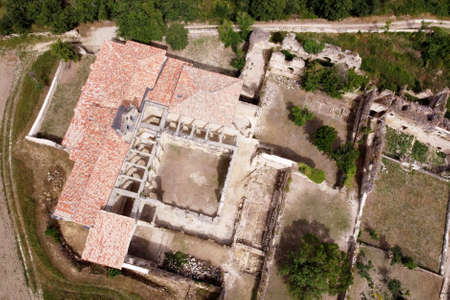 Aerial view of the Ruins Of An Ancient Abandoned Monastery In Santa Maria De Rioseco, Burgos, Spain.