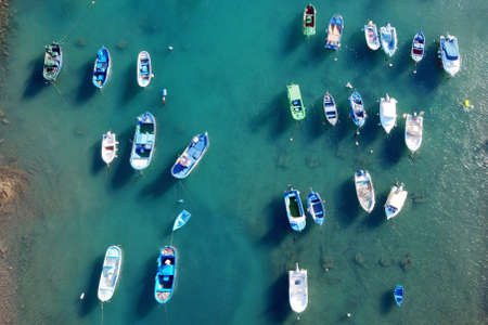 Aerial view of little fishing colorful boats in Tajao, Tenerife, Canary Islands.