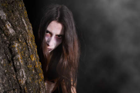 Scary ghost woman, halloween theme. Dark, fear. Stock Photo