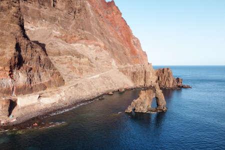 Natural Volcanic stone arch, Roque de Bonanza in El Hierro island, Canary Islands, Spain.
