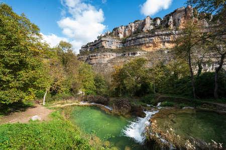 Beautiful pools of crystalline water flowing into the Ebro river in Orbaneja del Castillo, Burgos, Spain.