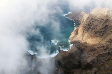 Flying over a scenic landscape, cliffs and ocean in a remote volcanic landscape of Tenerife, Canary Islands. High quality photography 免版税图像