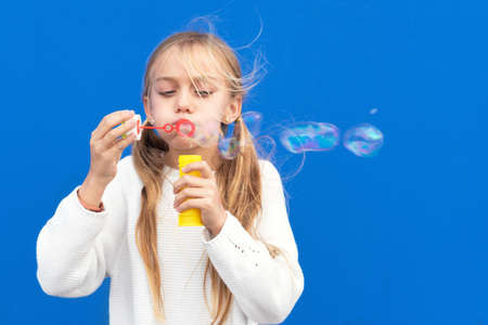 Funny girl blowing soap bubbles Reklamní fotografie
