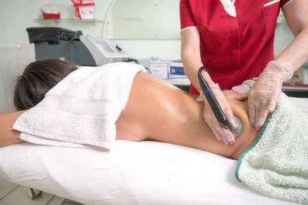 Radio Frequency bodyTreatment in beauty salon.