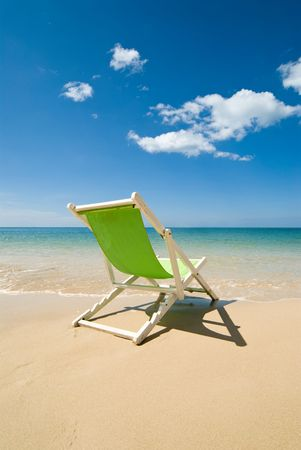 Green chair on beach Stock Photo