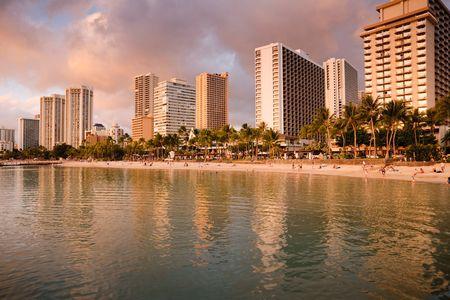Golden sunset on Oahus famous Waikiki beach