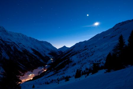 Extreme long exposure of a remote alp valley. Stars in motion.