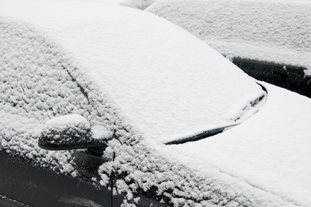 Close up of snow covered car windshield
