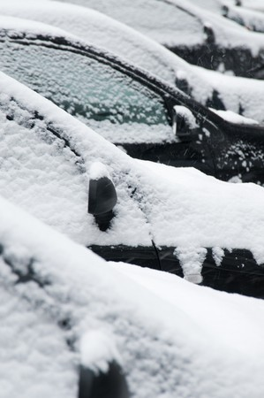 Close up of snow covered car from side