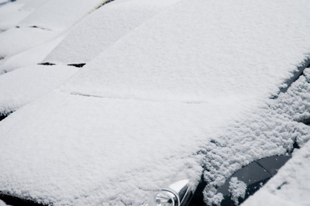 Close up of snow covered car windshields Stock Photo