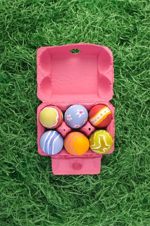 Pink box of easter eggs. Put your text in cap.