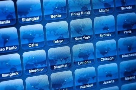 Icons of cities worldwide on monitor Stock Photo