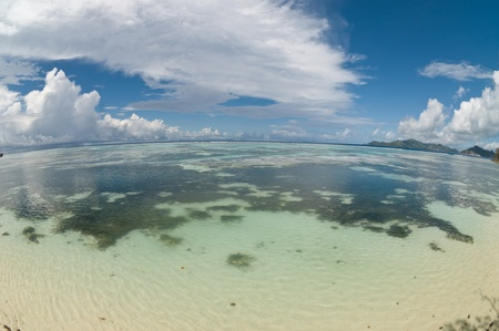 Fish-eye view of reef with clear water at La Digue - Seychelles Stock Photo