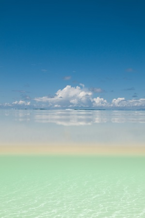 Split image of sky and sand under water