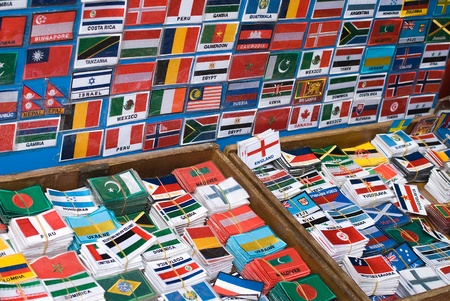 Boxes with patches of flags on a market in asia