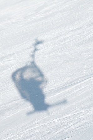 Shadow of chairlift in snow