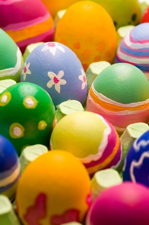 Close up of a bunch of easter eggs rough painted in a big egg carton