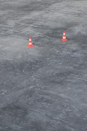 Pair of traffic cones on large area of concrete