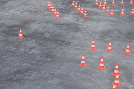 Bunch of traffic cones on large concrete area