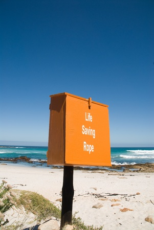 Life Saving Rope Box on the Beach Stock Photo