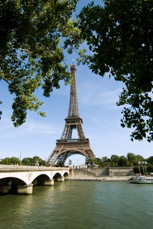 The Eiffel Tower seen from a pier at river seine