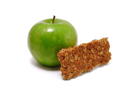Green Apple and Granola Bar isolated on a white background photo
