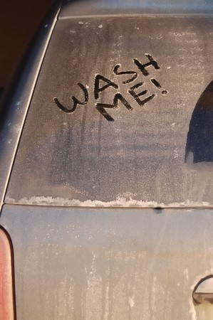 Dirty, grimy vehicle with the words