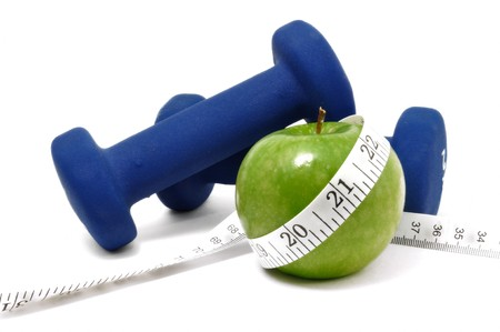 muscle toning: Blue weights, green apple, and tape measure isolated on a white background