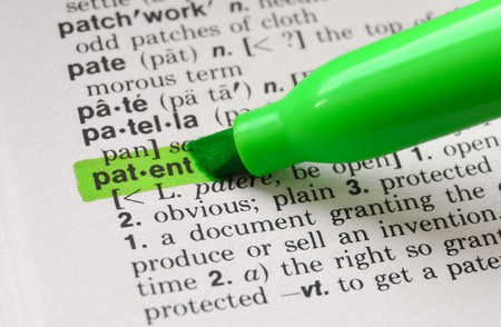 define: The word patent highlighted in a dictionary. Stock Photo