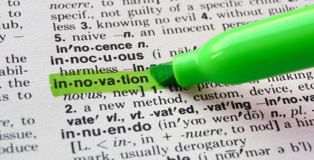 define: The word innovation highlighted in a dictionary. Stock Photo