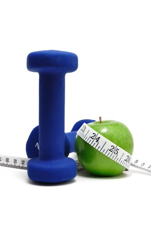 muscle toning: Blue weights, green apple, and tape measure isolated on a white background.vertical Stock Photo