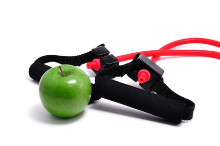 Resistance Band and Green Apple isolated on a white background photo