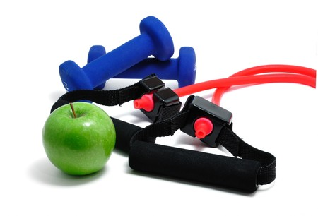 stretchy: Resistance band, blue weights and green apple isolated on a white background