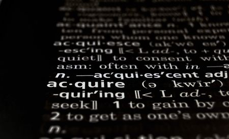 acquire: The word Acquire in a dictionary, white on black
