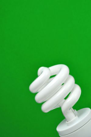 cfl: compact fluorescent light (CFL) with green background, vertical Stock Photo