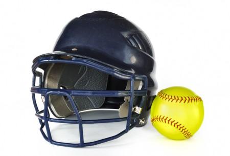 Helmet and Yellow Softball isolated on white
