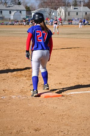 Teen Girl Softball Player on First Base, veritcal photo