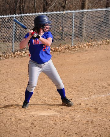 Teen Girl Softball Player Batting, vertical photo