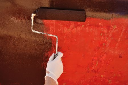drydock: Painting Sailboat Hull with a Roller, copy space Stock Photo