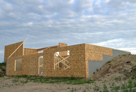 New house construction, framed walls of walk out basement, copy space Stock Photo - 4984884