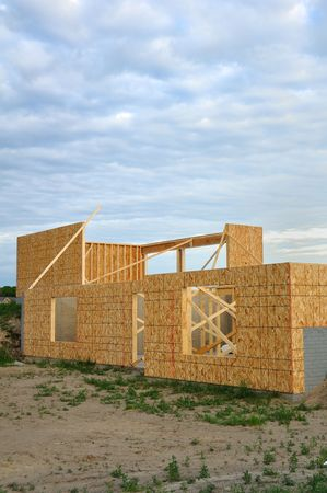2x4: New house construction, framed walls of walk out basement, copy space,vertical Stock Photo