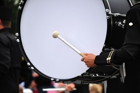 bass drum: Drummer Playing Bass Drum in Parade, Copy Space Stock Photo
