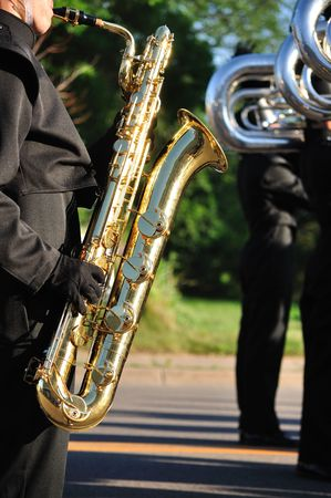 marching band: Marching Band Performer Playing Baritone saxophone in Parade, Copy Space, vertical Stock Photo