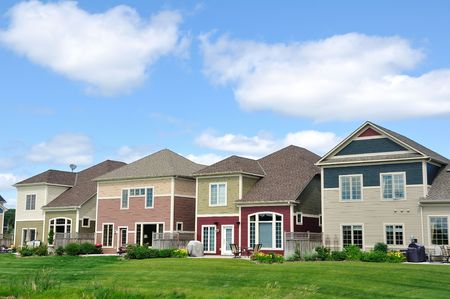 Multi-Colored Suburban Homes, real estate, copy space Stock Photo