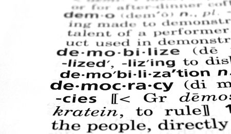 egalitarianism: The word Democracy in a dictionary, close-up Stock Photo