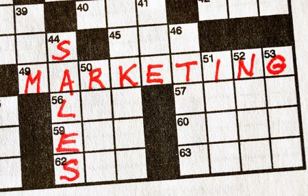 The Words Sales and Marketing on Crossword Puzzle in Red Ink, Copy Space photo