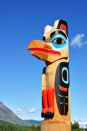 traditional culture: Eagle Totem Pole Against a Blue Sky located in Carcross, Yukon, Canada, Copy Space, Vertical